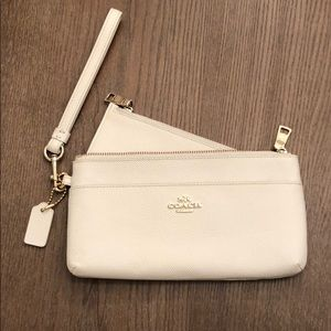 Cream colored coach wristlet. New without tags.